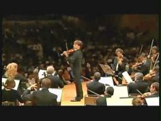 Joshua Bell Beethoven playing in a concert hall.