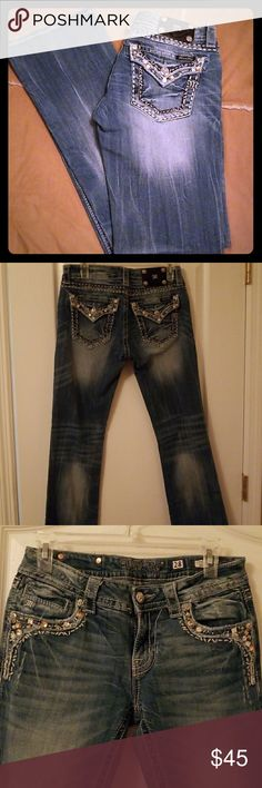 Miss Me Signature Boot Cut Jeans Excellent condition.... size 28 inseam 34... Beautiful Jewels and Stones on the back pockets and on the front pockets. These jeans have only been worn a few times. Miss Me Jeans Boot Cut