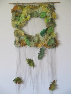 My interpretation of an Andy Goldsworthy leaf sculpture. This one is created from hand painted silk oak leaves.
