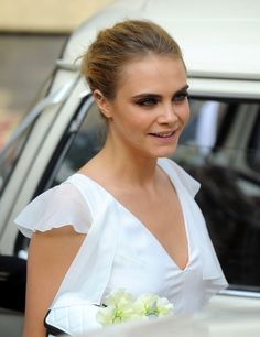 Cara Delevingne at her sister Poppy's wedding wearing Chanel (May 2014)