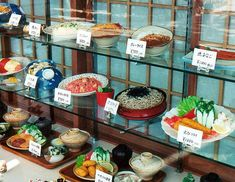 Plastic food in a Japanese restaurant. This is very helpful to foreigners who can't speak/read the Japanese. You just get bring the Japanese lady or man (usually the owners or family members) to the display and point out what you want.