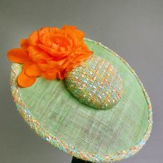 green and orange saucer hat sinamay with by MarcusArtandFashion