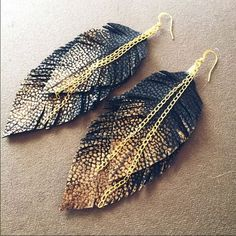 Black and gold leather feather earrings Chain is real gold. Two layers of Faux black leather, dabbed in gold paint. Approximately 5 inches in length. Brand new, hand made  Handmade Jewelry Earrings