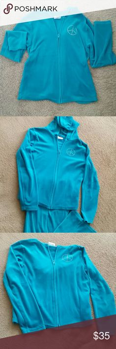 "SALE! NWOT 2 PIECE PEACE OUT BABY GURL! The most delicious shade of Aqua 2 piece fleece set! A bling peace sign adorns the Hoodie and matching pants adds a whole lot of mix & match options to any little girls wardrobe. Comfort and style assure this will quickly become a favorite ""go to"" outfit.   The last foto is closest to the green/blue turquoise color Danskin Now Matching Sets"