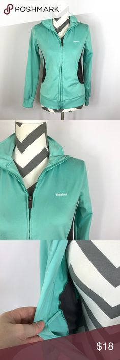 """{Reebok} Mint Blue Green Zip Front Jacket Very Good Pre-loved Condition! (Slight fabric flaw around the logo, see pic.)    Size:  S Measured laying down flat: 23"""" in length, 23"""" sleeve, 18"""" across bust Material: 100% Polyester Description: Mint Green warm up or athletic jacket w/ brown & white accent. Stretchy Poly Knit. Front pockets, zip front.   Comes from a Smoke Free Home Reebok Jackets & Coats"""