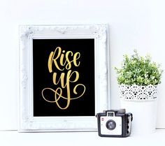 Have you seen the broadway Hamilton yet? Or are you just obsessed with the music like me? These 4 Hamilton quotes are a great reminder of the overall message to never give up and fight for our goals with passion.  Hand lettered and digitized by Sarah Ensign.  SIZE: :: 8x10 ready to be fit into the frame of your choosing  COLOR: :: Gold Foil on black cardstock  QUOTE: :: Rise up  PURCHASING PROCESS: :: Purchase :: Choose your shipping method :: Your print(s) will be shipped in 5-7 business…