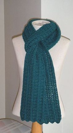 This is a fun and fairly quick scarf to make, even though it is made with a light sockweight yarn. It has good drape and is comfortable to wear.
