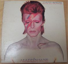 Aladdin Sane - David Bowie (1973)    And you thought Marilyn Manson was an original. David Bowie at the height of glitter rock in the late 60′s and early 70′s.  Click to see the inside cover photos.