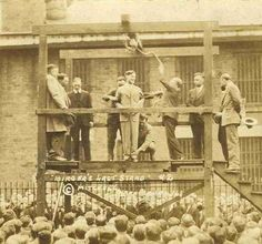 April 19, 1928. Benton Illinois: Charles Birger, bootlegger addresses the crowd before he is hanged.  He insisted on hanging in a black, not a white, hood — owing to his hatred of the Ku Klux Klan.