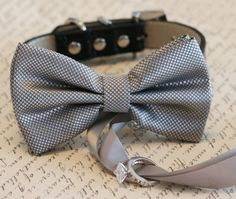 Silver Dog Bow Tie, Dog ring bearer, Pet Wedding accessory, Pet lovers, Silver bow attached to black leather dog collar, Silver wedding idea  • Collar Material: Leather • Collar Color: Black, Brown, Copper, Green, Gray, Ivory, Light Blue, Navy, Red, Royal Blue, Soft Pink, Purple or White • Bow Color: Silver • Ribbon Color: Silver   Collar Size • Size: Small 8- 11 • Size: Medium 11- 14 • Size: Large 14- 18 • Size: X Large 18- 22 • Size: XX Large 22- 26 • Please Email me size of her / his ...