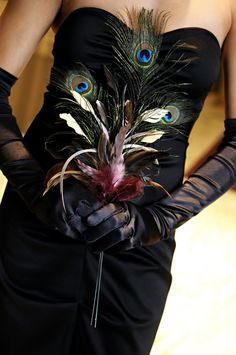 neat.. black and feathers.. fancy swanky... Stylish Baltimore Winter Wedding Bridesmaid Black Dress Peacock Feather Bouquet 275x414 Joy + Marks Stylish Baltimore Wedding at the Belvedere Hotel