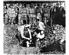 Nanking Massacre, 1937: Imperial Japanese soldiers burying Chinese civilians alive.