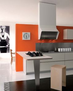 orange feature wall in kitchen