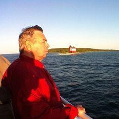 "@jamestodda's photo: ""a man, a boat, and a lighthouse"""