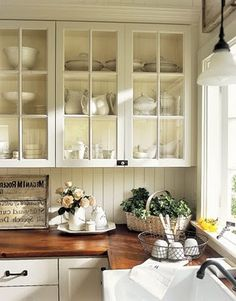 There's a lot to love in this kitchen. Wood counter tops, cabinets w/glass doors, and a farmhouse sink. There's a lot to love in this kitchen. Wood counter tops, cabinets w/glass doors, and a farmhouse sink. Farmhouse Style Kitchen, Kitchen Redo, New Kitchen, Kitchen Dining, Kitchen Country, Farmhouse Sinks, Kitchen White, Dining Room, Glass Kitchen