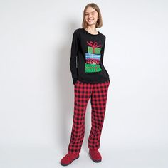 """Holiday comfortable pjs for women. Long-sleeve tee with present graphic logo print. Long pants with buffalo plaid print. Top, 24"""" on M and 25.5"""" on 1X; pant inseam, 28.5"""" for missy and 29.5"""" for plus size.FEATURES• Rounded neckline"""