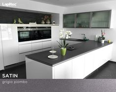 Lapitec® Satin in Grigio Piombo adds the perfect amount of soft contrast to this warm, contemporary kitchen.