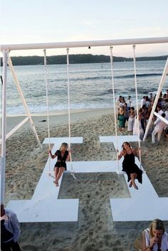 Hermes Sydney beach party. LOVE the large swing over the Hermes 'H'