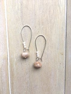 Long kidney earwires with sunstone beads and faux mother of pearl beads.