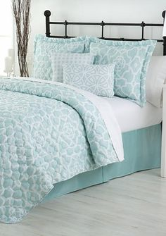 Decide which look fits you best with the this quaint, dainty quilt set. This classy collection features a blue and white geometric design reversing to another geometric design with the same shades of blue and white. The set includes a reversible quilt, bedskirt, reversible shams, and reversible decorative pillows that can be mixed and matched for multiple looks!