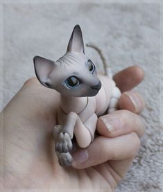 More Russian doll creators - a 3D printed cat in multiple sizes!  cat_sphinx_color_0006__