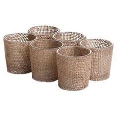 "Set of six burlap-wrapped glass votive holders.  Product: Set of 6 votive holdersConstruction Material: Burlap and glassColor: NaturalAccommodates: (1) Votive candle each - not includedDimensions: 2.5"" H x 1.75"" Diameter each"