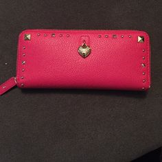 Juicy couture wallet Authentic juicy couture wallet. Used, great condition. Hot Pink patent leather with Gold studs Juicy Couture Bags Wallets