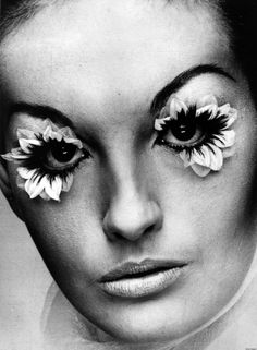 http://www.huffingtonpost.com/2012/10/02/false-eyelashes-eye-makeup-60s_n_1917695.html    Take these flower false eyelashes from 1969, for example. While the model looks completely stunning, it would be hard to pull off eye makeup like this today... outside of Halloween. The fluttering lashes in this photo were produced by Eylure in London and made out of fake flower petals and real hair.