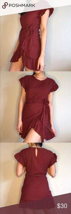 Ruffle Wrap Dress Such a cute and wearable basic to add to your personal wardrobe! Bought from an online shop and the color just didn't work for me. However — it's a beautiful, rich burgundy that would look great on blondes and brunettes! Features ruffles at the sleeves and at the bottom to flatter your arms and legs. There is also a side zipper and a keyhole back. This has only been worn once total, so take advantage! NOT vintage, tagged for exposure, it's actually an LA boutique brand xo…