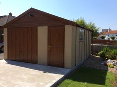 Another Apex 20 sectional buff brick garage Concrete Garages, Prefab, Brick, Shed, Outdoor Structures, Bricks, Barns, Sheds