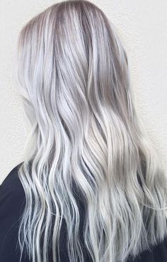 It doesn't get any more whiter and brighter than this folks! Platinum hair color by Erika Salter.