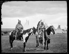 This photo titled No Shirt and Wife, of members of the Walla Walla tribe, taken in 1903.