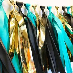 Teal black and gold tassel garland by ShopSwP on Etsy