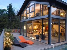 A couple has converted an old industrial workshop into a spacious steel and glass living space in Toulouse, France. Modern and bright, the translucent structure took a year to reconstruct. The residence features incredible views to the nearby park. There are three rental apartments in the lower part of the voluminous home, the couple, Marie …