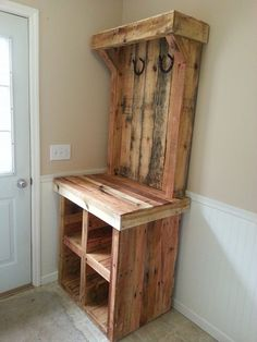 Build a rustic pallet coat rack for your mudroom.  -- like the general idea of combining shoe cubbies/drop zone table/hooks