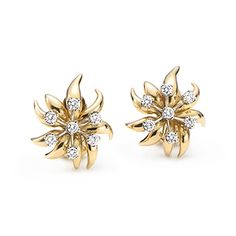 Schlumberger Flame ear clips in 18k gold with diamonds. $5,500.00 Tiffany & Co.
