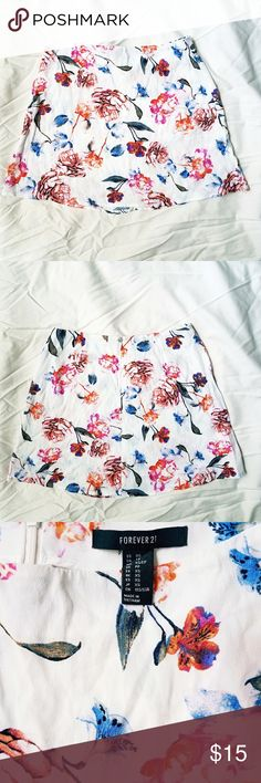 Forever 21 Floral Mini Skirt Beautiful Watercolor Floral Pattern. White Background Mini Skirt. Looks great with a Bright Crop or Tucked in Blouse. A little sheer (just wear white undergarments). No stains or signs of wear. Forever 21 Skirts