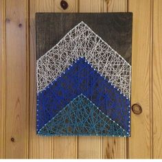 Priced to move! 📦 This triangle piece went from $45 to $25 and can ship out tomorrow 👍🏼ONLY ONE LEFT - check it out at our Etsy store. #triangle #triangles #blue #blues #homedecor #home #art #stringart #nails #handmade #madeinmaine #mountains #mountain #maine #newengland #sale #etsy #homedecoration #bohochic #bohemian #bohoart #artsy
