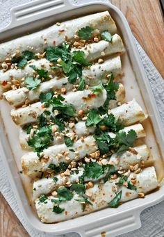 these Thai Chicken Enchiladas are one of the most popular recipes on my site. SO good!  I howsweeteats.com
