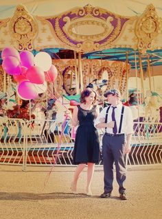 I looovee her dress, and his hat...it's just like Allie and Noah in The Notebook! (but with balloons)