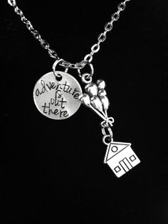This necklace is inspired by Up. This necklace includes a silver engraved charm with the phrase adventure is out there along with two silver charms,