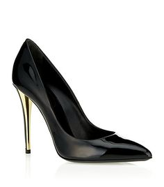 Yves Saint Laurent's sleek Clara pump. Finished with a luxurious gold-tone panel at the heel, this timeless pair are a must-have example of the label's elegant aesthetic. product code 2910547