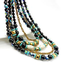 Black beaded multistrand necklace with turquoise and howlite beads.  Let this one of a kind Multi strand Black and white howlite,turquoise