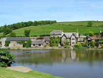 """Malston Mill Cottage - """"Overlooking the lake, this cottage has original mill workings in the oak-beamed ceiling, its own private drive and a garden with BBQ."""" - http://www.watersidebreaks.com/description/malstonmillcottage.htm"""