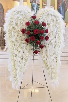 Angelic and majestic these unique wings are the perfect way to send your loved o. - Funeral flowers - Angelic and majestic these unique wings are the perfect way to send your loved one off in style wit - Casket Flowers, Grave Flowers, Cemetery Flowers, Funeral Flowers, Angel Flowers, Silk Flowers, Purple Flowers, Funeral Floral Arrangements, Creative Flower Arrangements