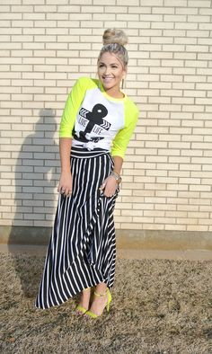 I love this quirky little outfit! Funky baseball tee + striped maxi + neon stilettos + top knot. Too cute!