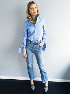 Pernille Teisbaek of Look de Pernille wears a turtleneck, button-down shirt, seamed jeans, and heeled loafers