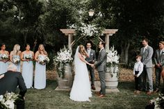 rustic wedding ceremony decor with light blue shades and white accents