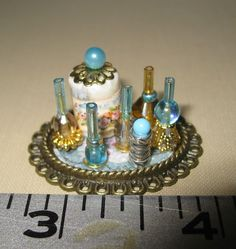 Beautiful dollhouse miniature vanity tray with sky blue perfumes & powder