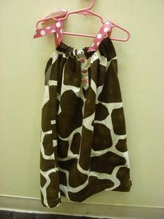 Giraffe print pillowcase dress with pink trim and buttons.  About size 6